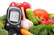 Verschiedene Gemüsearten und ein Blutzucker Messgerät